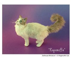 Miniature cat sculpture by Kerri Pajutee
