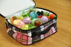 What a cute idea for your kid's lunch! A mom at my kid's school packed hers in half an egg carton instead of the plastic grass.  I had lunch duty that day and I appreciated the less messy version!! :)