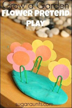 Pretend play and fine motor skills with flowers and play dough.  {Sugar Aunts}