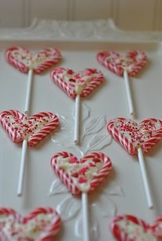 Christmas candy cane hearts for valentines... if you want to make these for Christmas use green sprinkles!!
