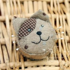Handmade Delight: Kitty Cat Pincushion. Made using a bottle top.