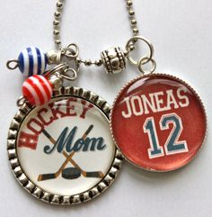 Items similar to Hockey Mom necklace with number mom grandma nana childrens names sport jersey number team colors custom cute bling hockey stick puck on Etsy Hockey Decor, Hockey Gifts, Hockey Mom, Field Hockey, Hockey Teams, Ice Hockey, Hockey Stuff, Sports Mom, Sports Gifts