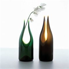 Recycled handcut wine bottle vase with sandblasted matte finish made from recycled post-consumer wine bottle.