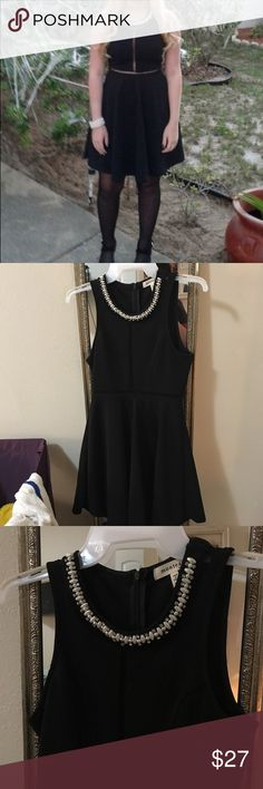 Homecoming pearl & beaded with mesh dress Pearl and beaded neckline with mesh lines on the chest. Worn once no flaws. Tag reads XS can fit a small Dresses Midi