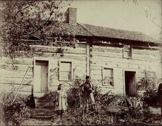 """MarionCabin_1901_.jpg On the back, in my G-Grandmother Marilla Anderson's hand: [and her spelling]  """" The house where my Father was born, June 22, 1822 - Marion, Smythe County, Virginia - His sister Maggie and little girl Daisy standing in yard - Nov. 6th, 1901""""  Courtesy of Suze moreach@netzero.nete"""