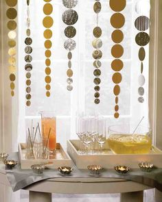 Leftover paper gets a fresh start when used to make decorations for a party. We used metallic paper to make streamers of shimmering circles that descend from above.
