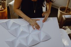 DIY geometric paper backdrop - photo by Megan Saul Photography http://ruffledblog.com/diy-geometric-paper-backdrop