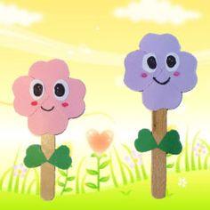 Hier laat ik je zien hoe je leuke bloemetjes kan knutselen van geknipte hartjes en ijslolliestokjes.