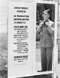 An unidentified airman checking his uniform in a mirror before passing through the exit gate at RCAF Station. / Un aviateur non identifié vérifie son uniforme dans un miroir avant de passer les portes de sortie à une station de lARC by BiblioArchives / LibraryArchives, via Flickr. Rockcliffe, Ontario, Canada. July 28, 1943.