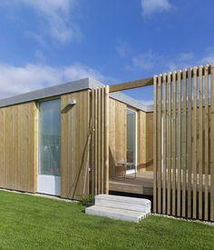 Seven Modular Housing in Covas / Salgado e Liñares Architects