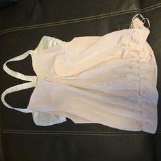 Lululemon workout top EUC- light pink with light grey lines throughout fabric. Built in bra, side cut outs. Washed with lulu, never dried. lululemon athletica Tops Tank Tops