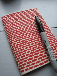 A6 Red brick notebook by Louise Smurthwaite