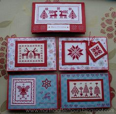 Cross stitched cards with Scandinavian motifs