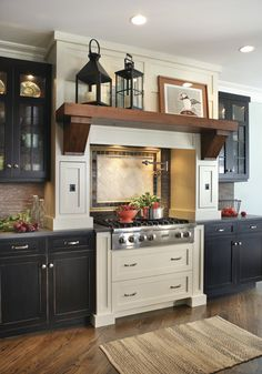 Woah!  That giant shelf on top of the stove is incredible!  The navy cabinets + all of the finishes make this a true dream kitchen!