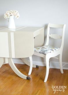 How to Update a Classic With Chalk Paint® by Annie Sloan  This Duncan Phyfe style is such an old classic. I gave the table a clean, timeless look with Country Grey paint. The chairs were painted in Old White. I kept my brush strokes smooth and lightly sanded between coats to keep the look crisp and clean!