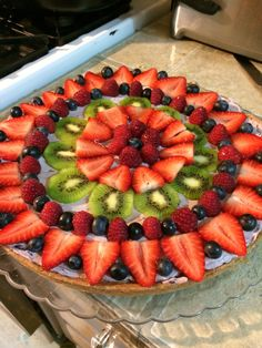 Organic fruit pizza! Sugar cookie crust and whipped, blueberry cream cheese 'sauce'