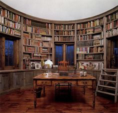 Round library in a converted barn silo - love this idea