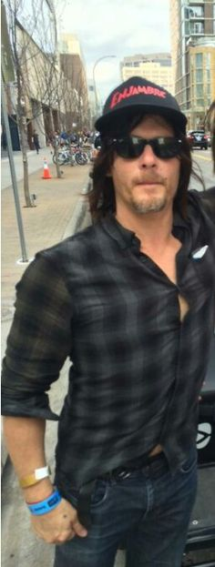 Norman Reedus... His shirt wants to come off so badly..