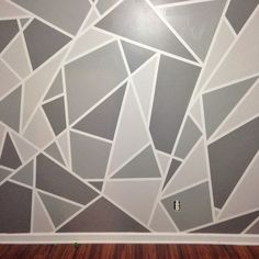 This is a geometric mosaic wall in grey ombre. Beautifully done. #ombre #grey #walldecor #gorgeous