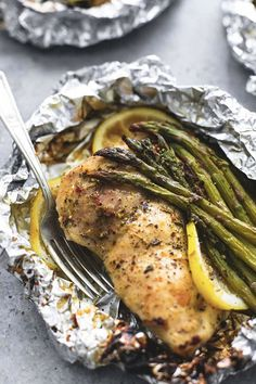 Lemon chicken and asparagus foil. 15 Foil-Packet Dinner Recipes that Make Cleanup a Breeze #purewow #dinner #grilling #easy #food #recipe #cooking #foilpacketrecipes #foilpackets #campingrecipes #lemonchicken