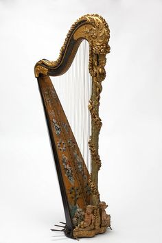 Pedal harp        Place of origin:        Paris, France (made)      Date:        ca. 1785 (made)      Artist/Maker:        Nadermann, Jean-Henri, born 1735 - died 1799 (maker)      Materials and Techniques:        Carved giltwood and painted pine, with metal mechanisms