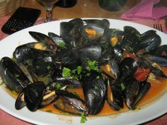 A good ale makes a fantastic cooking medium for mussels. Avoid cheap, light lagers or very heavy stouts and instead go for a real ale with a bit of lightness and some floral, grassy, herbal notes. Seafood Recipes, Snack Recipes, Cooking Recipes, Seafood Meals, Snacks, Steamed Mussels, Belgian Style, Stuffed Hot Peppers, Fish And Seafood