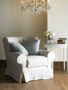 i love the rounded back of this overstuffed chair i looks comfy and styled