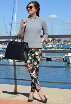 @roressclothes clothing ideas #women fashion Black Handbag floral trousers gray sweater