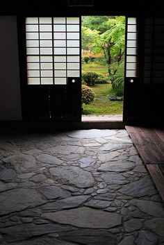 Japanese garden #GISSLER #interiordesign- Contrast between wood and stone, reverse door pulls