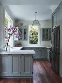 I love the grey/blue kitchen cabinets