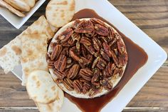 Kahlua Pecan Baked Brie - An elegant yet simple appetizer recipe. Creamy, buttery Brie topped with salty buttered pecans in a Kahlua brown sugar sauce. | www.worthwhisking.com