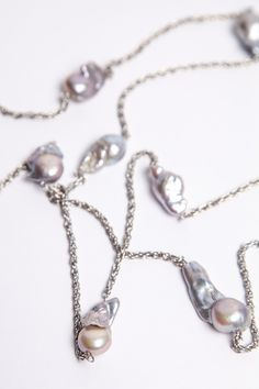 A personal favourite from my Etsy shop https://www.etsy.com/sg-en/listing/237247820/silver-baroque-pearl-station-necklace