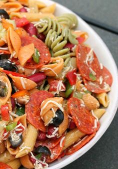 Tuscan House Italian Pasta Salad -- Ready for a dinner party in just 20 minutes, this cool side dish is sure to be a hit at your next get-together. Recipe and photo by blogger, Liz Mays, of www.anutinanutshell.com
