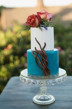 The striking blue adds a rich design element to this wedding cake. click to see more gorgeous wedding cakes; via Sugar Bee Sweets Bakery