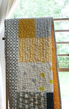 @Shea Parker Parker Parker Parker Parker Hladnick maybe we need a new family quilt!!  hint hint.  yellow - gray quilt