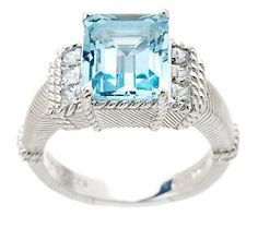 I love the color of the stone ... so beautiful!  Judith Ripka Sterling 5.00ct Blue Topaz and Diamonique Ring at www.qvc.com