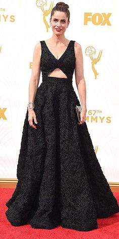 The Most Gorgeous Gowns on the Red Carpet at the 2015 Emmys | AMANDA PEET | A black Michael Kors Collection gown is anything but boring when it's got gorgeous, rich texture, an abs-baring cutout, and is worn with a gold-trimmed Salvatore Ferragamo clutch and the perfect red lip.