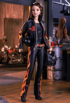 Harley-Davidson® Barbie® Doll ~~ Harley-Davidson® Barbie® doll wears a fun, edgy black leathery ensemble with orange flames. A black leatherette jacket with real working zipper proudly features the world famous logo. Intricately detailed, this outfit is accented with a silvery chain, black backpack, and boots. A sleek black helmet and sunglasses make Harley-Davidson Barbie® unforgettable.