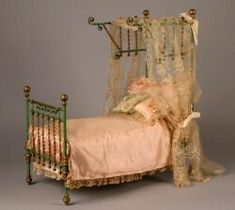 ORNATE METAL FASHION DOLL BED, FRANCE, C. 1860, - THE MAURINE POPP COLLECTION OF DOLLS - SALE 2196 - LOT 50 - Skinner Inc