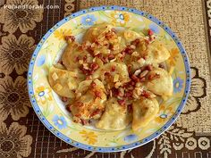 Pierogi- Can be filled with cabbage and meat, or fruit, or potato and cheese topped with polish sausage and onions @Jessie Poland