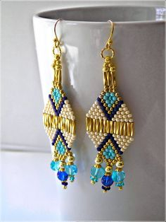 Southwestern Native American Inspired Jewelry This earrings feature beautiful complimentary color combinations that are highly desirable all year round. The warm cream color serves as a neutral pallet for the royal, dark blue, turquoise family of blues. These woven earrings are