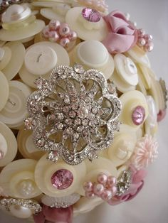 .buttons and rhinestones covering a styro ball...