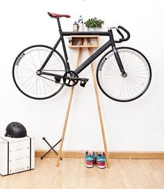The Bike Wardrobe is a unique and modern furniture design and concept. Bike Rack is made from solid alder and acacia wood. The clever design keeps the bike clean and shining by keeping it off the ground up and away. Hanging Bike Rack, Indoor Bike Rack, Bike Hanger, Decoration Design, Deco Design, Design Design, Bike Wall, Bike Storage Solutions, Storage Ideas