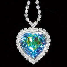 """Remember the """"Heart of the Ocean"""" blue-diamond necklace in Titanic? Meet its celestial counterpart, inspired by the northern lights! This heart is a generously sized, faceted Swarovski aurora-borealis crystal, surrounded by diamond-bright Austrian crystals and suspended on a crystal-accented chain. Silverplated."""