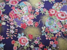 This traditional Japanese fabric is really beautiful. It is purple in colour with flowers, leaves and temari balls all over it with gold accents.