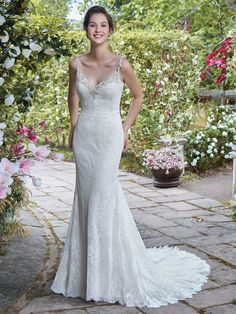 Rebecca Ingram - HELENA, A sweet and simple sheath with a hint of glamour, this allover lace wedding dress features Swarovski crystal, pearl, and bead accents along the V-neckline and spaghetti straps. Sheer lace trim and ruching detail complete the low scoop back, accented in beaded lace appliqués. Finished with covered buttons and zipper closure.
