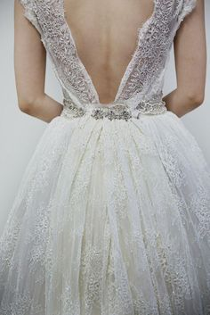 So so cute!  Backless and low-back wedding gowns are my favorites, and I've always loved a pouffy skirt.  -Ann