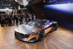 2013 Peugot Onyx concept car.  Kind of cool but kind of weird with the copper sides.  Seems like it would turn green after awhile!
