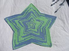 While this star shaped afghan sports the usual gaps parallel crochet stitches form, a modified hdc2tog and an adjacent dc stitch fill in the cracks normally made by chains on an increase and skippe…