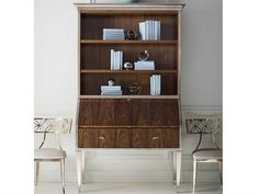 Dressed to impress, this traditional English-inspired secretary feels modern from every vantage. Its classic silhouette is refreshed and on-trend with a Rich Walnut finish highlighting its exquisite wood grains complemented by a contemporary shade of Charcoal Leaf on its legs and crown. Open the drop-down lid and you'll find a smart work surface and drawer compartments for staying organized while open upper shelves are perfect for storage and display. Bedroom Office, Office Decor, Open Shelving, Shelves, Caracole Furniture, Secretary Desks, Modern Desk, Work Surface, Walnut Finish